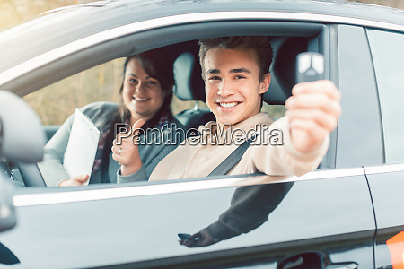 happy student of driving school showing
