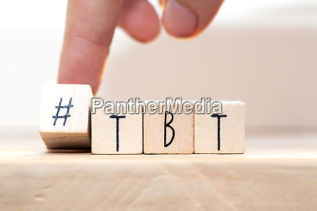 wooden cubes with hashtag tbt meaning