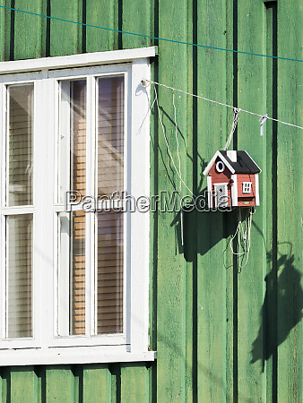 birdfeeder on colorful house small town