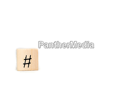 wooden cube with hashtag isolated on