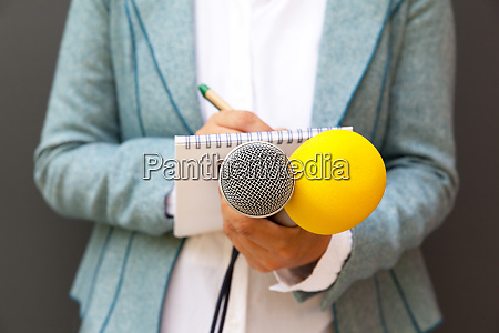 journalist at news conference
