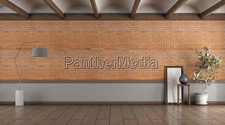camera vuota con muro di mattoni